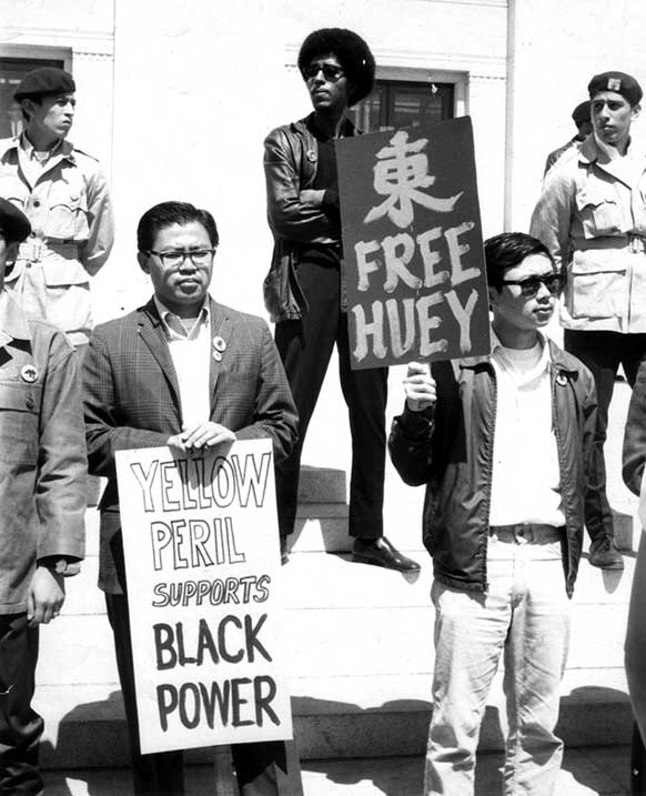 """Yellow peril supports Black power""  Oakland, CA 1968. Photograph by Roz Payne"